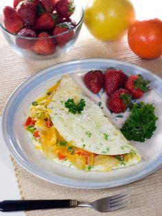 ½ red pepper  ¼ teaspoon butter or 1 tablespoon olive oil 3 eggs or 4 egg whites 2 tablespoons milk 4 grape tomatoes, halved Salt and pepper