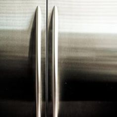 Remove a deep scratch from a stainless steel refrigerator with sandpaper.