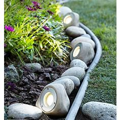 Natural and unobtrusive, this LED landscape light kit adds a great touch to your garden and is made to look and feel like real garden rocks LED landscape lighting kit; each rock light is 4 high x wide… Continue Reading → Landscaping With Rocks, Front Yard Landscaping, Backyard Landscaping, Landscaping Ideas, Backyard Ideas, Landscaping Edging, Tropical Landscaping, Large Backyard, Traditional Landscape