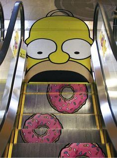 Homer Simpson eating donuts on an escalator.
