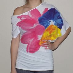 Victoria's Secret One-Shoulder Tee Size S but runs large. Fits more like a M. Gorgeous flower graphic on front. Longer so it scrunches at the bottom and will cover your rear if you wear with leggings. 60% cotton, 40% modal. Victoria's Secret Tops Tees - Short Sleeve