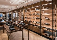 The forest trees are translated into wall fixtures, becoming Silver Deer's new trade mark; versatile, flexible and consistent throughout the perimeter. Visual Merchandising, Shoe Store Design, Retail Boutique, Retail Shop, Shoe Display, Store Interiors, Wall Fixtures, Retail Space, Design Furniture