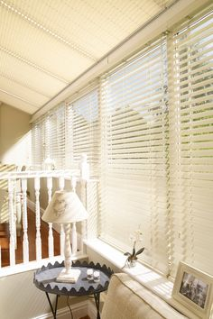 Venetian blinds can help create privacy and let the light the in your conservatory when needed. Use cream or white colours to maximise the light within the room.