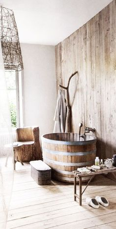 A customized tub in beautiful rustic style. The interior of the bathroom itself is a tribute to rustic style and complements amazingly with the wooden furnishings.