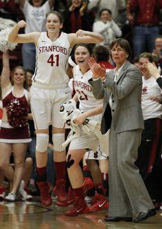 Stanford's Bonnie Samuelson (41), Sara James (21) and head coach Tara VanDerveer react vs Cal