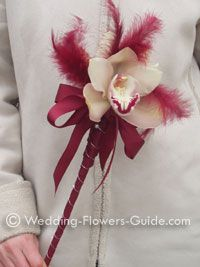 feather wand with cymbidium orchid...for the flower girls, using a lily instead of an orchid.