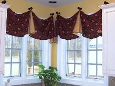 dark red embroidered silk with yellow silk accents.  Trim at edges, hung on finials from thefinialco.com