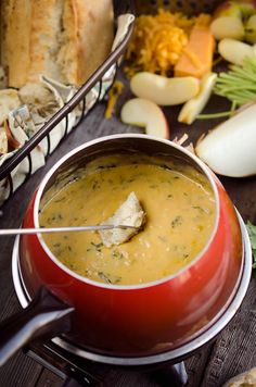 Zesty Cheddar Fondue is an easy and delicious appetizer perfect for the holidays. It is a creamy cheese fondue filled with rich sharp cheddar, onions, garlic and cilantro that pairs perfectly with bread and apples.