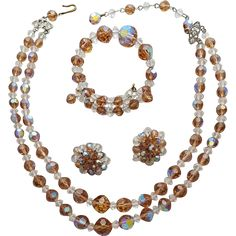 1960s crystal parure, necklace bracelet and earrings in faceted ice tea and white beads. Measurements : Necklace 13 - 15 inches, Bracelet small to