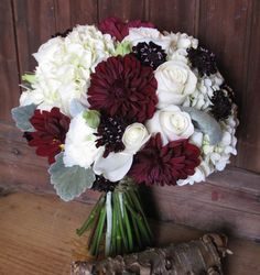 Bouquet of white hydrangea, burgundy dahlias, scabiosa, roses, lisianthus and dusty miller for a silvery accent.