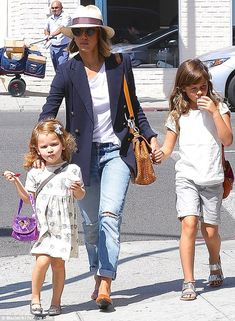 Accessorized: Jessica's daughters looked precious ins silver shoes and hair bow pieces...
