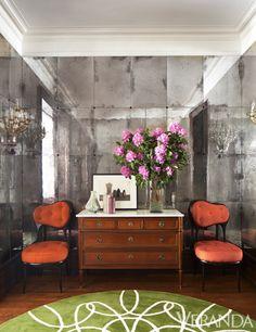 like the custom mirrored wall in the foyer.  Looks like mercury glass.