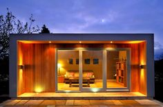 Bepoke-Garden-Room-Gym-Log-Cabin-Shed-Timber-Frame-Home-Hot-Tub-Play-BBQ-Room. Lighting makes the building.