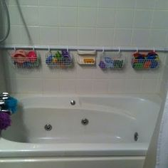 Duh!!!!! After all of the frustration with the lame suction cup hangers ... Shower Rod against back wall with wire hanging baskets for tub toy storage. - Click image to find more kids Pinterest pins