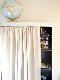 Use an bookcase, tension rod with a curtain to hide the mess.. this will be useful