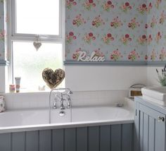 Wallpaper in the bathroom screams vintage chic, while sanding down and re-painting tongue-and-groove panels captures the mood perfectly. Stick to duck egg shades and mix with pretty floral prints for a country cottage bathroom you'll love spending time in.