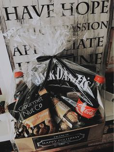 For him. Birthday hamper with alcohol (Jack Daniels) mixer and snacks.