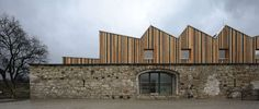 Architekti converts a stone barn into a woodwork facility with a serrated timber extension Building Structure, Building A House, Cladding Materials, Roof Extension, Fish House, Stone Barns, Old World Style, Affordable Housing, House Roof