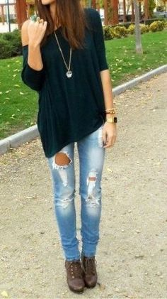 black shirt with ripped jeans & boots
