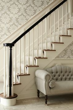 ML Interior Design: Elegant foyer with silver gray damask wallpaper paired with wainscoted staircase wall.