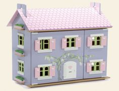 The Le Toy Van Lavender Dolls House is fully decorated inside & out with opening windows, opening shutters, an opening front door and a removable roof with upper floor (3 floors in total).  It is very easy to slot together and assemble.    The dolls and dolls house furniture are sold separately.