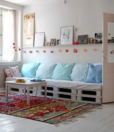 A beautiful modern bright living room with a pallet turned into a couch in the center