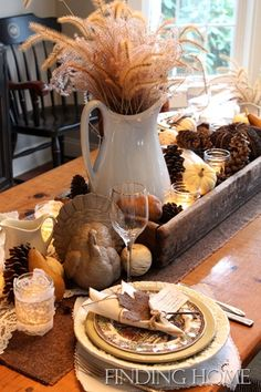 Tablescape of Wooden Tray, Pinecones & Pumpkins, Pitchers, Lace Votive Holders, Leaf-Key-Lace-Tag Napkin Holder by Finding Home