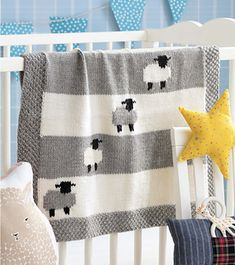 Gray and white sheep, knitted intarsia-style, frolic across this adorable blanket—the perfect project for a knitter and her favorite little lamb. Sleepy Sheep pattern by Jacob Seifert Grace Osborne graceaosborne baby shower Gray and white sheep, kn Baby Boy Crochet Blanket, Knitted Baby Blankets, Baby Afghans, Baby Girl Blankets, Crochet Blanket Patterns, Baby Knitting Patterns, Baby Patterns, Crochet Baby, Free Knitting