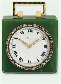 AN ART DECO NEPHRITE TRAVEL CLOCK, BY CARTIER, 1925..........