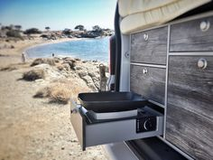 VanEssa mobilcamping kitchen comes with a draw for a gas stove and wind protector to keep the gas from blowing out while your cooking.