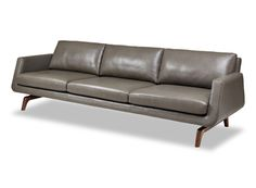 Expanding our longtime collaboration with the legendary designer John Mascheroni, the Nash collection creates a mesmerizing effect as the upholstered seating appears to float above the elegantly shaped walnut or ash legs. As with all Mascheroni designs, the accent is always on comfort, but there's quite a bit of contemporary attitude, too, with crisp, clean lines and angles.