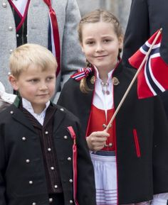 Princess Ingrid Alexandra and Prince Sverre Magnus greet the Childrens Parade on the Skaugum Estate on May 17, 2014 in Oslo, Norway