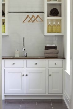 Smoke Grey Glass Subway tile in laundry/mud rooms - modern laundry room, white laundry room cabinets, laundry room cabinets, butcher block top, butcher. Laundry Room Tile, Modern Laundry Rooms, Laundry Mud Room, Mudroom Laundry Room, Home, Modern Room, Cabinet, White Laundry, Room