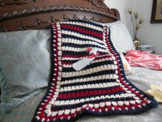 loom knitted honey comb stitch center with crocheted edging baby blanket with a whale & anchor felt applique I made