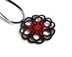 Black tatted lace pendant - round motive - rosette with red colour beads on Etsy, $14.00