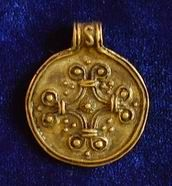 Solar pendant. Cross in the circle symbolizes the Sun.  The Eastern slavs, the town of Lutsk, 11th Century.