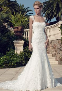 Brides: Casablanca Bridal. This fitted A-line silhouette features beaded lace appliques on tulle over Gossamer Lace and the hemline is finished with scalloped eyelash fringe. Gown has a modified soft sweetheart neckline and crystal buttons are along the zipper. This gown can be worn with or without the detachable, sheer beaded lace cap sleeves.��More Details From Casablanca Bridal