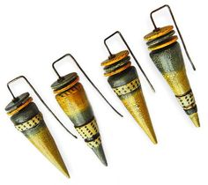 France's Sonya Girodon has had quite a time coming up with versionsof these Ray of Sunshine cone-shaped earrings. This series has a crackle finished base with polka dot embellishment topped with flat disks. The square earwires make a geometri [...]