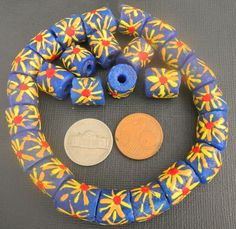 They are back: blue beads with flower pattern.