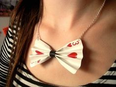 Inspiration... I found a queen of hearts card and turned it into a necklace with chain and a clasp. The center part was electrical tape. I gave it to my friend as a closing night present for our school play, Alice in Wonderland. She loves bowties and was also Alice, so she deserved a present. :)