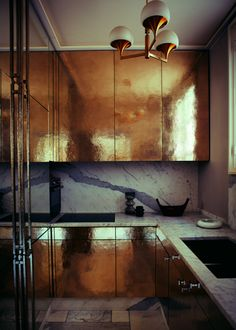Paris, Left Bank apartment in COLOUR by Abigail Ahern. Jean-Louis Denoit. TDF kitchen! Hammered gold cabinets + marble = heaven.