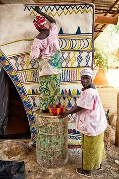 Ndebele South Africa. Painting the house.