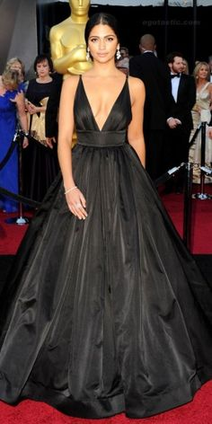 Style and Color Type: Chic/Star  Camila Alves looked sexy and glamorous in a plunging voluminous Kaufman Franco black satin dress with flawless hair and makeup to boot. If you do black, it needs to be this good. – Sarah