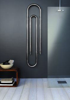 Towel warmer shaped like a paper clip. Cool art looking piece, but not sure how ., Towel warmer shaped like a paper clip. Cool art looking piece, but not sure how towels would hang well on this one. Decorative Radiators, Bathroom Radiators, Kitchen Radiators, Radiators Uk, Bathroom Blinds, Master Bathroom, Designer Radiator, Towel Warmer, Minimalist Interior