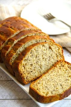 Greek Yogurt Banana Bread -- so soft and tender that you'd never be able to tell it's made without butter or oil! DELICIOUS!    runningwithspoons.com