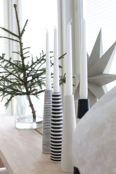 A Scandinavian Christmas. Placing sleek monochrome and black and white striped candleholders on the window sill will bring warmth to the home. (Source: Salad Days)