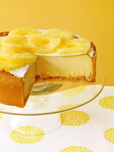 This ultra-rich cheesecake has pineapple above and below. A crushed pineapple filling is spread over the crust and topped with the cheesecake batter while pineapple slices decorate the top.