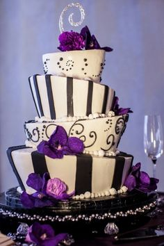 This cake is adorable! But make the accents fuschia instead of purple...lol