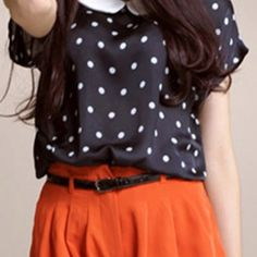 this poka dot shirt shows ellegance and fits the body.