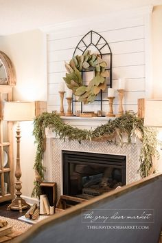 Joanna gaines home design style fireplace fixer upper style living room decor rustic farmhouse style fireplace . joanna gaines home design Farmhouse Fireplace Screens, Fireplace Wall, Fireplace Design, Living Room With Fireplace, My Living Room, Living Room Decor, Fireplace Ideas, Fireplace Cover, Fireplace Garland